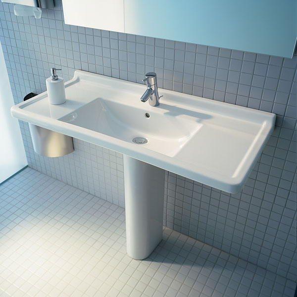 This looks large but comes in a smaller size. I like the side space for soap and hand towels.