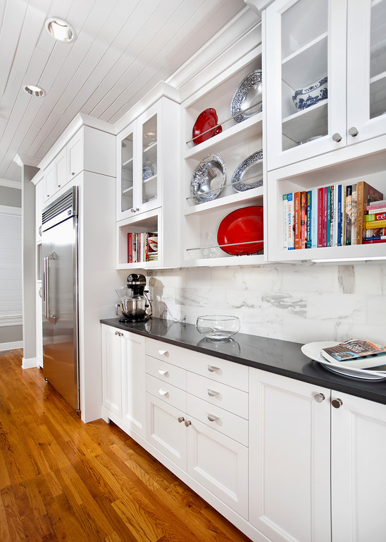 The butlers pantry area offers great storage as well as being attractive.
