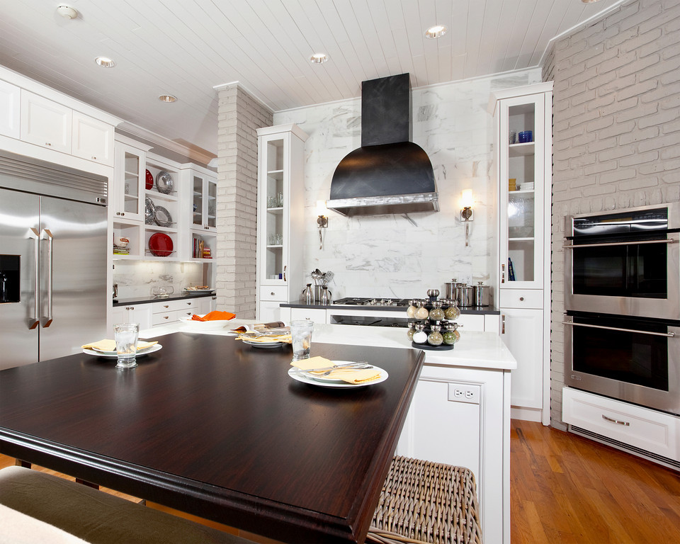 """Wenge wood """"table"""" provides a nice counterpoint of warm wood tones with the cooler white cabinetry!"""