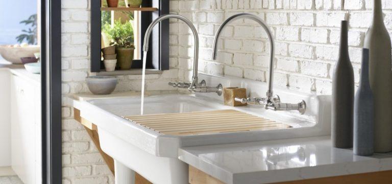 White brick garden kitchen, silestone sink, countertops, plants, grey trim