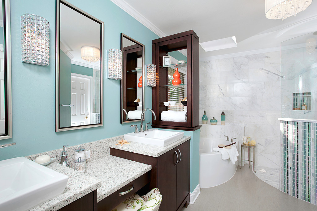 Master bath remodel with over-sized tub, blue walls and glam accessories, and enlarged shower