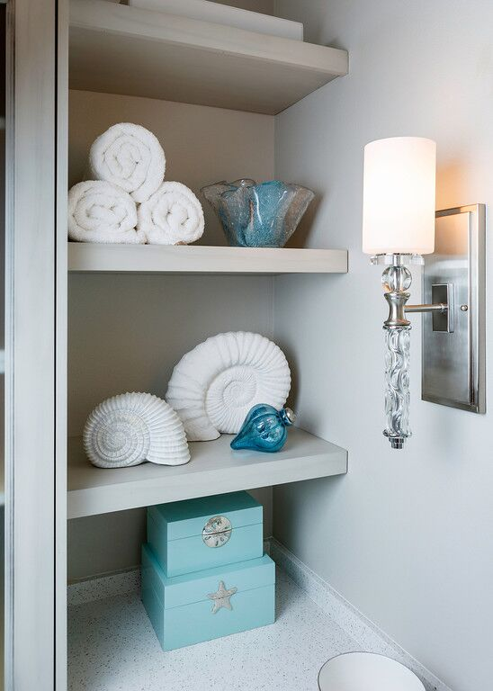 Open shelves, sconce, stone top, grey cabinets