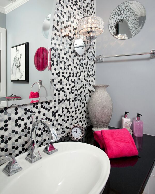 Mosaic Penny tile, Mosaic Backsplash, Black top, white sink, polished nickel faucet, sconce, artwork,