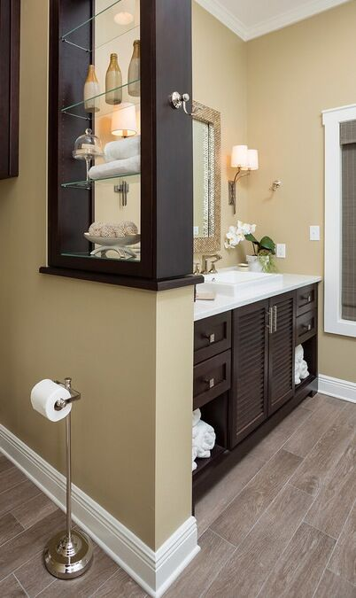 Master bathroom remodel with sophisticated style: custom cabinets, dark stain, porcelain tile