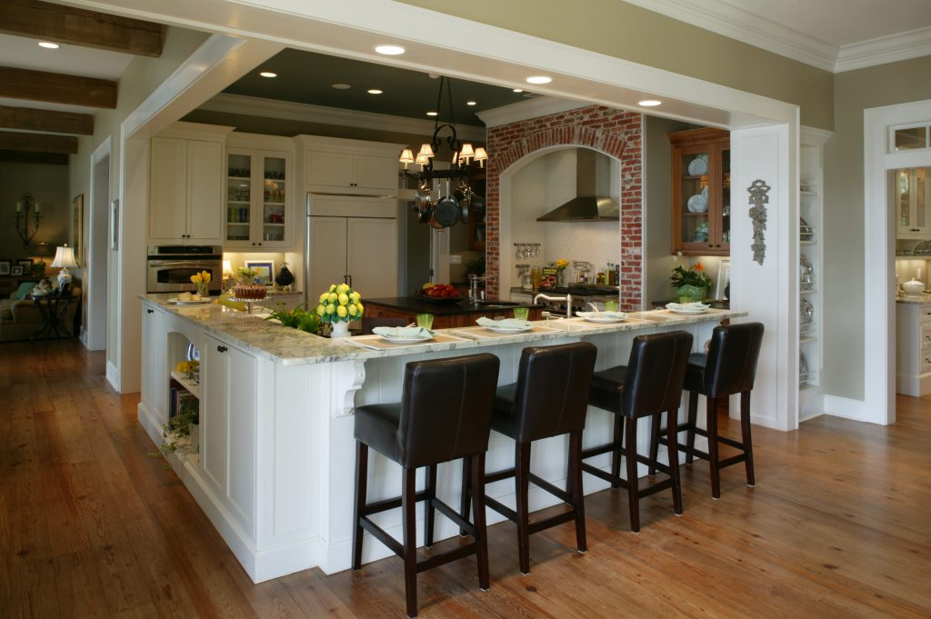 New construction country kitchen: granite counters, subway tile, perimeter island, bar stools, exposed brick