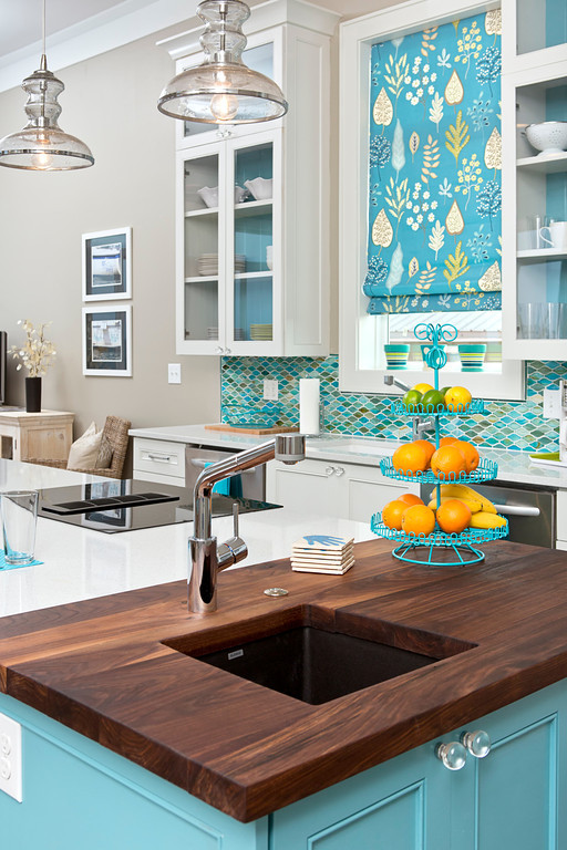 Coastal Kitchen with Wood counter tops and blue cabinets