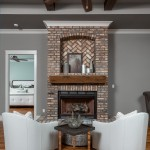 chairs, fireplaces, brick, newly constructed, traditional living, casual yet sophisticated, living space, custom home