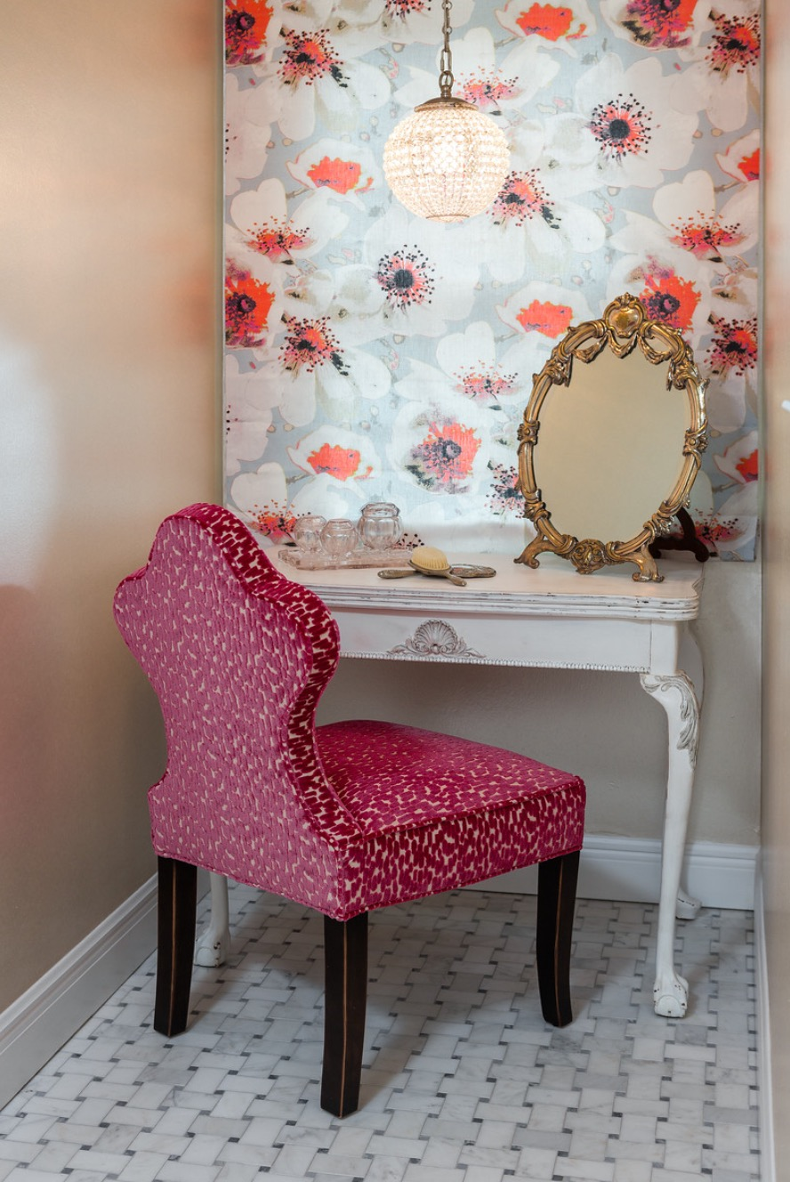 A repurposed small flip top table now is home to a quaint make up area.