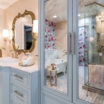 beautiful girl's bathroom remodel with blue vanity and gold and pink accents