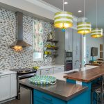 New construction coastal duplex, kitchen, blue and white, yellow, tile back splash, kitchen island, eat-at bar, pendant lighting, floating shelves