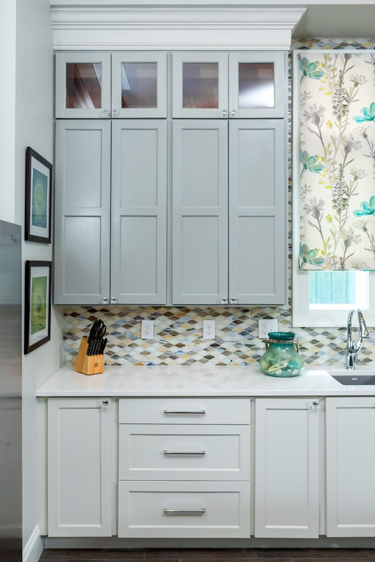 - Gulf Shores Project: coastal duplex, new construction, blue and yellow, two toned cabinets, tile back splash