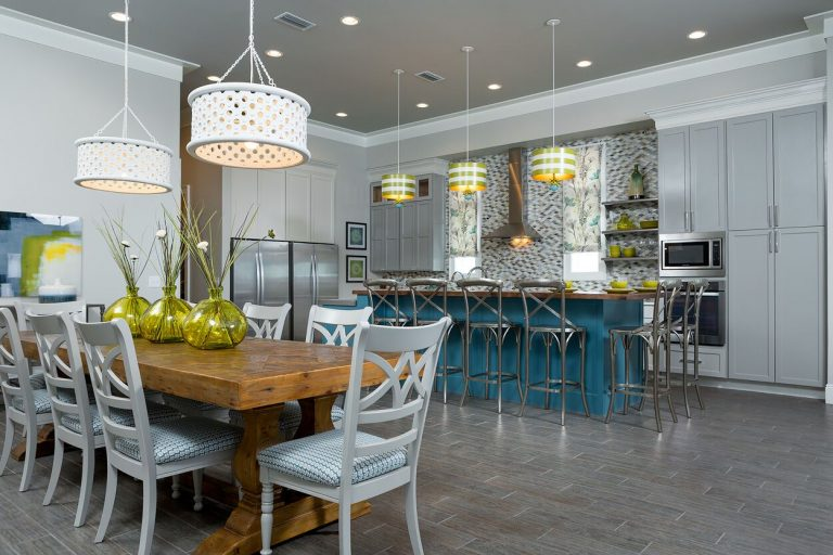2016 NKBA Budget Kitchen Winner - Gulf Shores Project: coastal duplex, new construction, blue and yellow, kitchen island, floating shelves, tile back splash, pendant lighting, dining table, recessed lighting