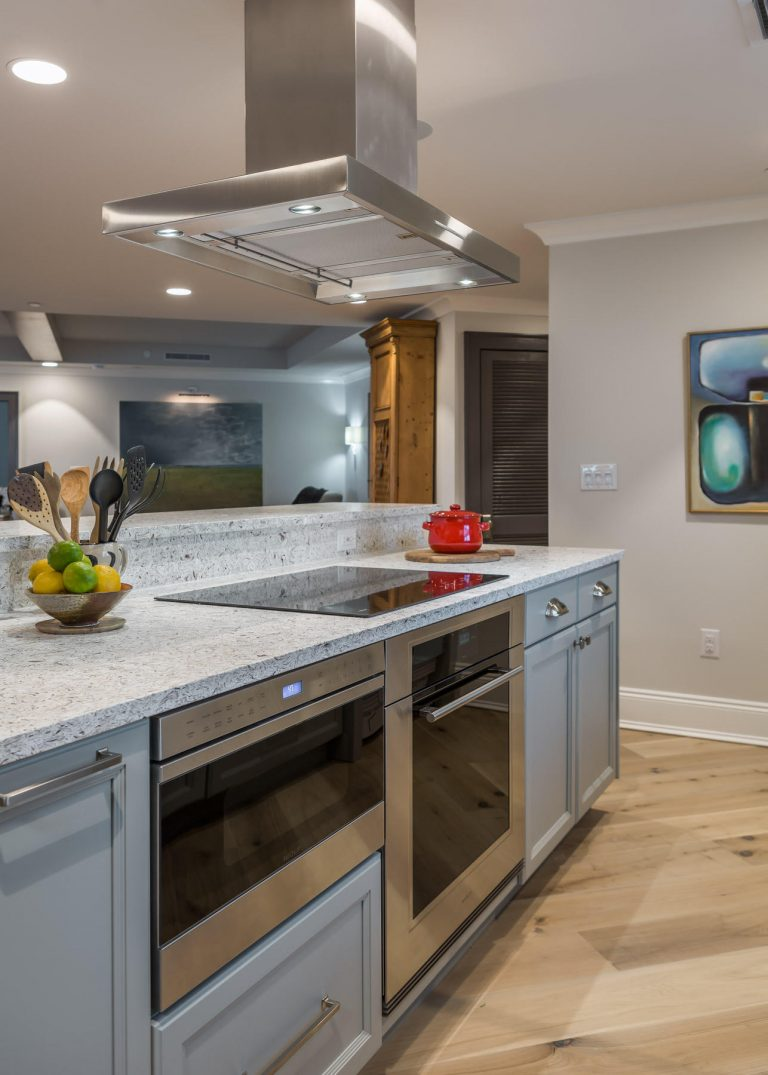 Penthouse Suites Re-Imagined: Unique Remodel: grey cabinets, light counter top, range, oven, induction cooking