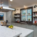 Penthouse Suites Re-Imagined: Unique Remodel: two toned counters, grey cabinets, floating shelves, kitchen island