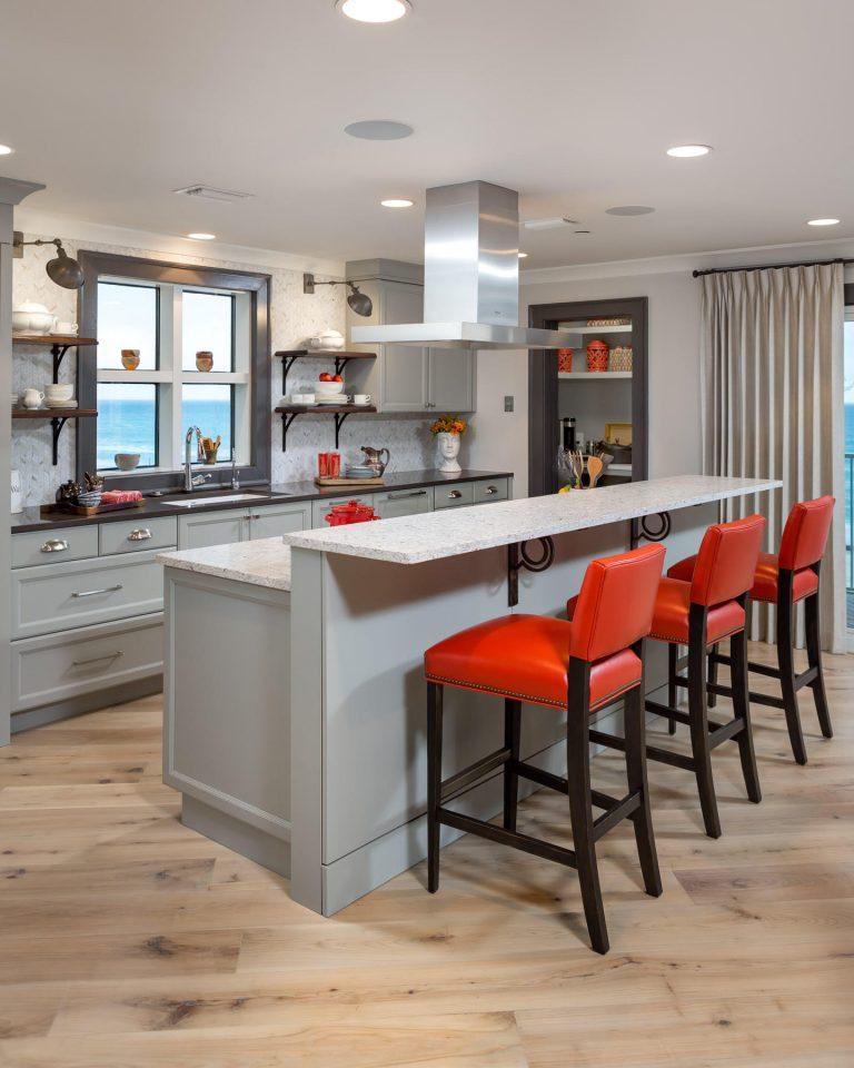 Penthouse Suites Re-Imagined: Unique Remodel: kitchen island, bar stools, grey cabinets, floating shelves