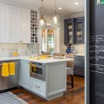blue, white and yellow kitchen remodel - blue and white cabinets, white counter tops with yellow accents