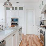 white kitchen with light floors