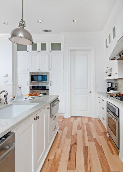 white kitchen with light floors
