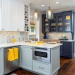 blue, white and yellow kitchen remodel - blue and white cabinets with white counter tops and silver pendants