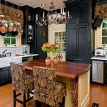 Historic Home in Old Mobile: Calcutta gold marble, dark cabinets, custom copper hood, 48 inch range, island with distressed walnut top, prep sink, main sink