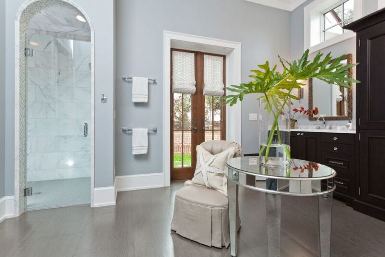 contemporary bathroom with light blue wall paint marble tile shower plenty of natural light custom cabinets