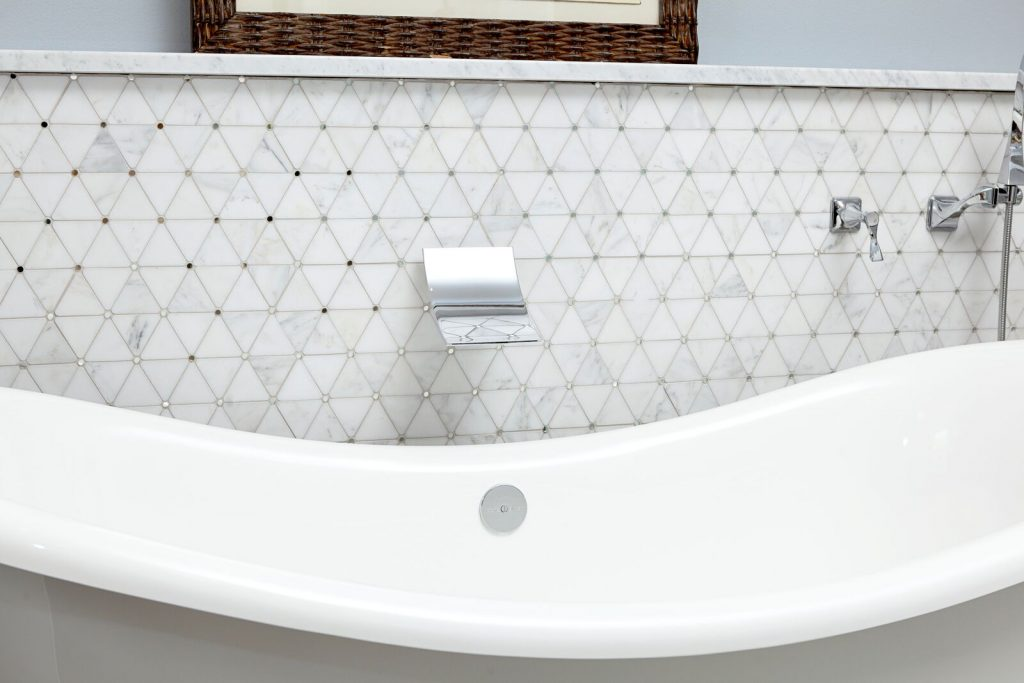 Organic master bath: new construction, blue and white, free standing tub