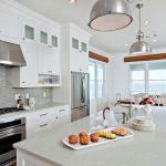 New construction, white kitchen, caesarstone, kitchen island, stone back splash