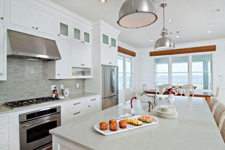 New construction, white kitchen, caesarstone, kitchen island, stone back splash