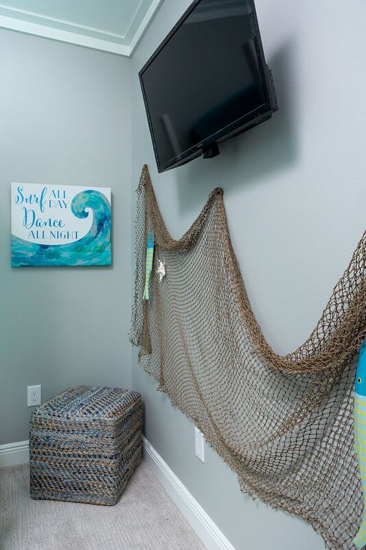 Coastal new construction blue and white bedroom with fish net detail