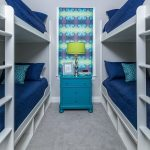 New construction coastal duplex, bedroom with bunk beds, blue and white, green and purple, window treatment