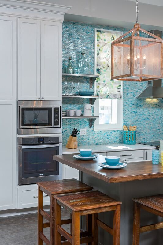 Coastal new construction blue and white kitchen, two toned cabinets, island, eat-at bar, floating shelves, tile back splash