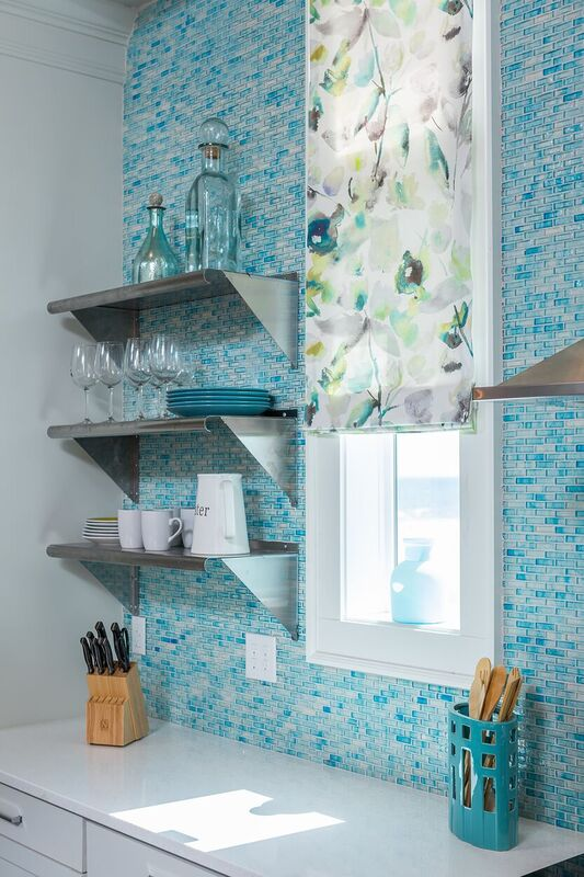 Townhouse duplex new construction in coastal community: blue tile back splash, floating shelves, patterned window covering