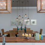coastal new construction dining area and eat-at bar with pendant lighting