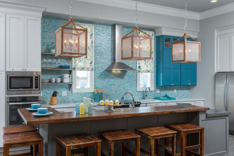 Duplex kitchen new construction in coastal community: blue, tile back splash, island with bar seating