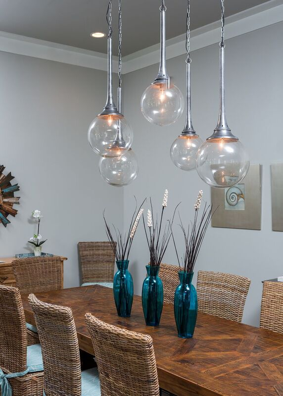 Coastal new construction dining area with pendant lighting, blue and white