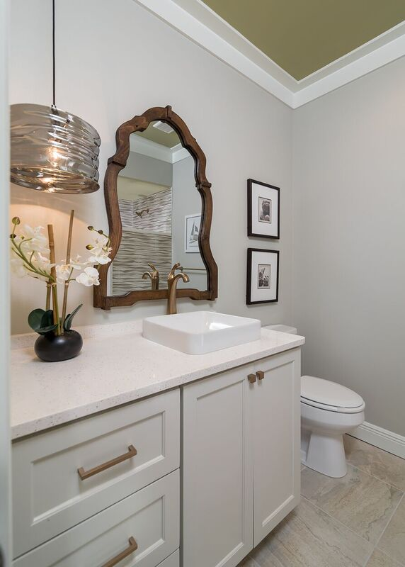 Budget bath with light neutral colored vanity and walls with pendant light fixture