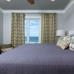 New construction coastal duplex, bedroom, window treatments, patterns, blue and white, green and yellow
