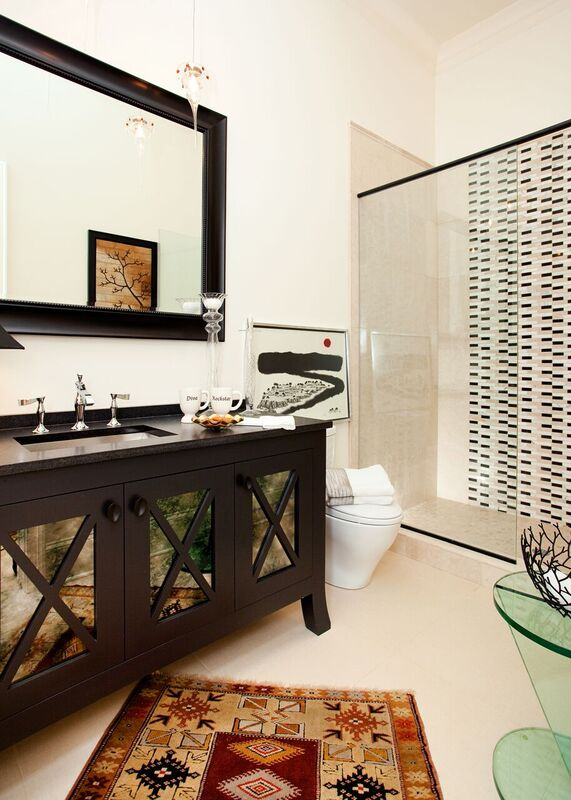 Bathroom with dark vanity with large mirror and glass shower, Pensacola Florida Bath Remodel