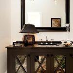 Bathroom with dark vanity and large mirror, Pensacola Florida Bath Remodel