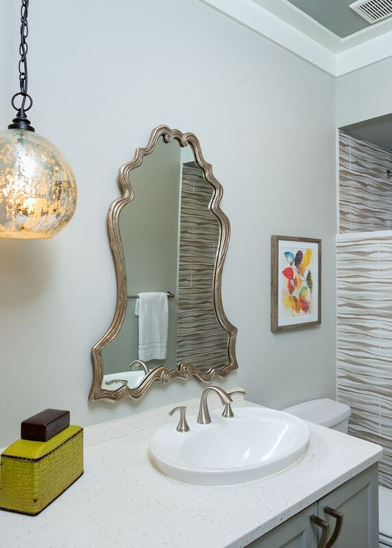 Budget bath with neutral colors and metallic pendant light fixture