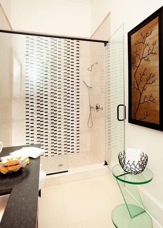 Bathroom shower with tiled walls and glass door, Pensacola Florida Bath Remodel