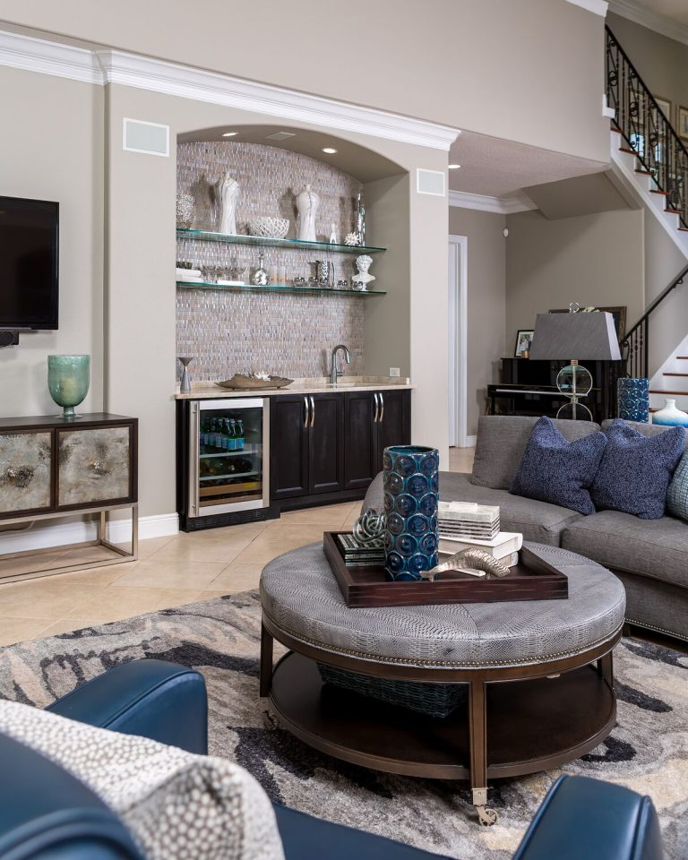 Living space for a busy family, built ins, greys, blues, and sand tones