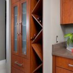 custom wine rack, cabinets, glass fronts, stone countertop, tile backsplash