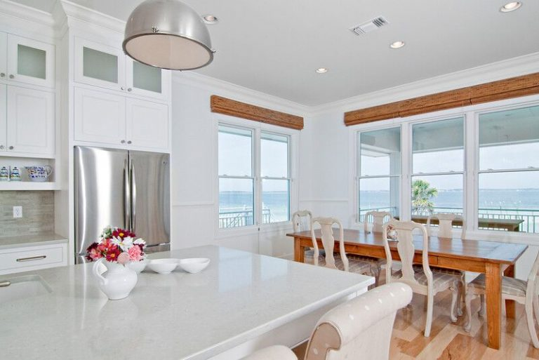 New construction, white kitchen, caesarstone, kitchen island, stone back splash, beach views