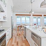New construction, white kitchen, caesarstone, kitchen island, stone back splash, beach views