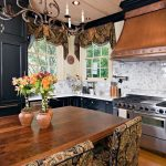 Historic Home in Old Mobile: Calcutta gold marble, dark cabinets, custom copper hood, 48 inch range, island with distressed walnut top