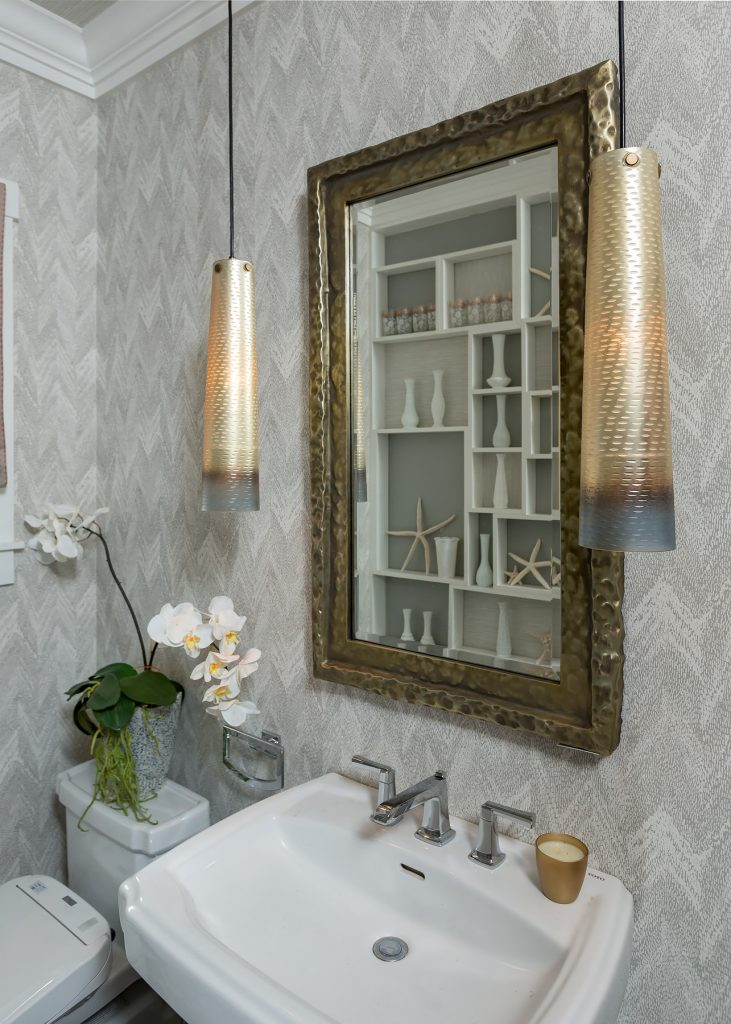 The style of fixtures in a powder bath is oh so important to the overall design plan.