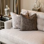 Upholstered sofa, custom throw pillow, table lamps, side table