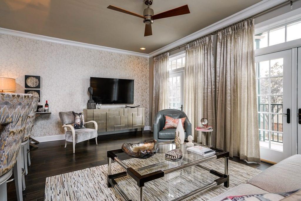 Leather swivel, hide rug, accent chair, custom window treatments, t.v console, custom barstools, wall art