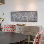 Custom upholstered dining chair, original artwork, beautiful console table and hanging light.